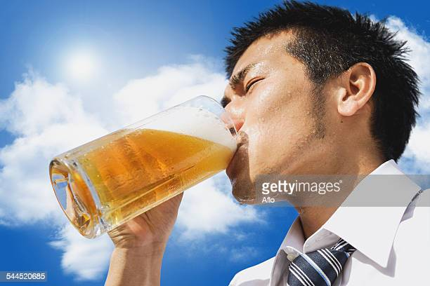 Japanese businessman drinking draft beer
