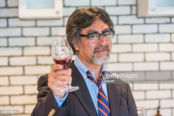 Japanese Businessman Enjoying a Glass of Wine Relaxing After Work