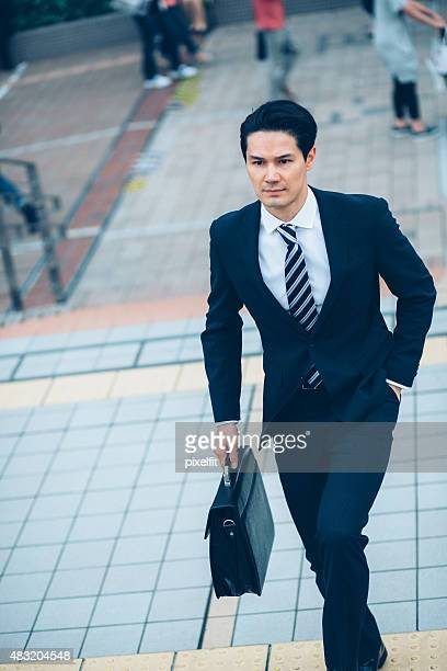 Japanese businessman fast at the street