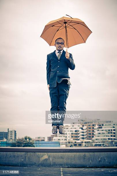 Japanese businessman floating above Tokyo