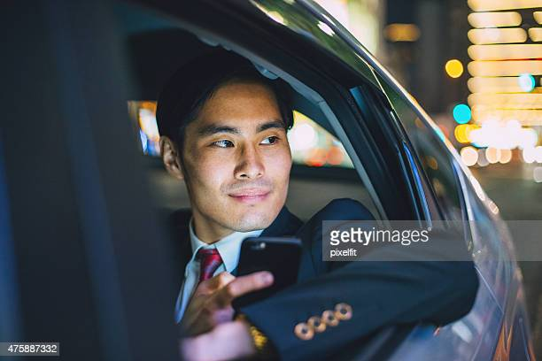 Japanese businessman in a car at the night