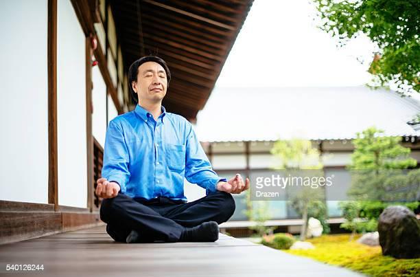 Japanese businessman in Chijon-ji Shrine meditating after hard working day