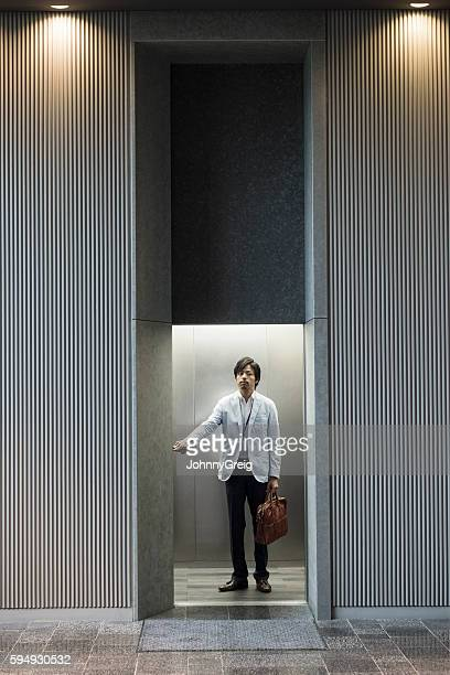 Japanese businessman in modern office lift