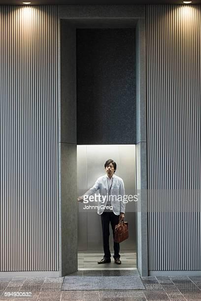 Japanese businessman in modern office lift