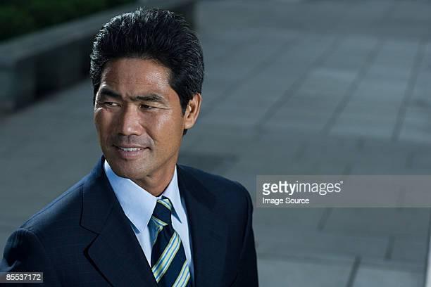 Japanese businessman on a sidewalk