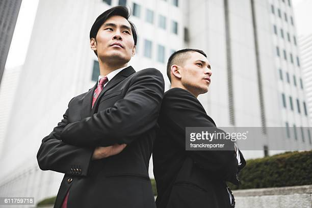 japanese businessman portrait standing on the city of tokyo