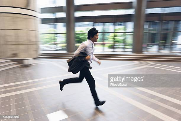 Japanese Businessman Running To Arrive On Time