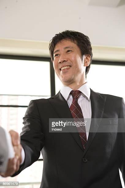 Japanese businessman shaking hand