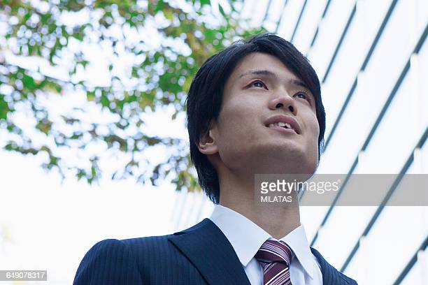 Japanese businessman who look up to the sky