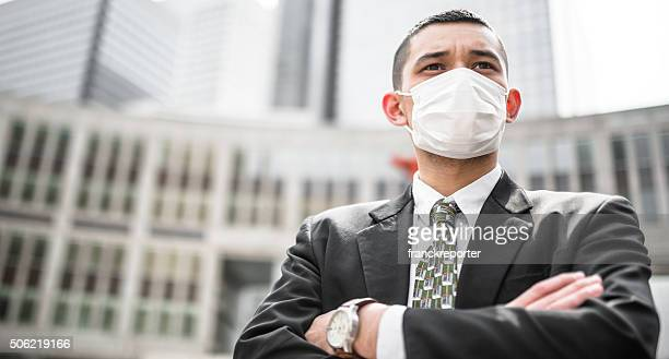 japanese businessman with a pollution mask fighting the flu