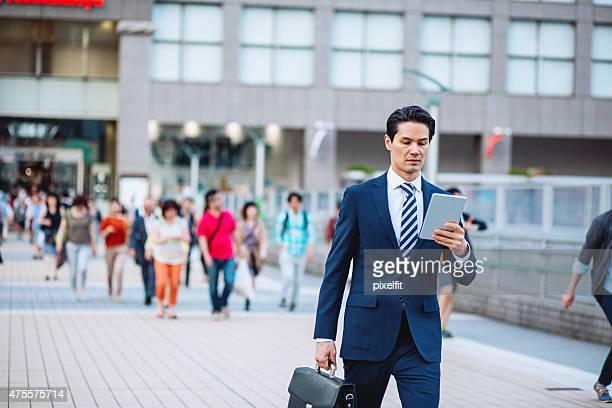 Japanese businessman with digital tablet in Tokyo street