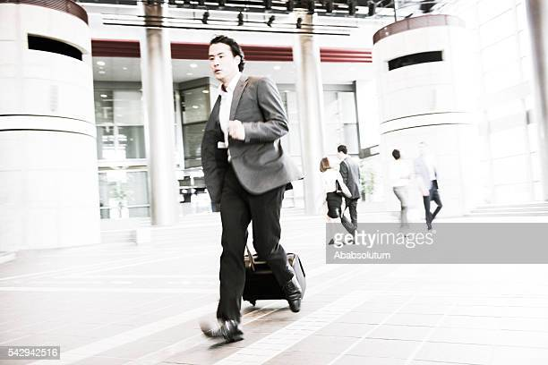 Japanese Businessman with Suitcase Running, Kyoto, Japan