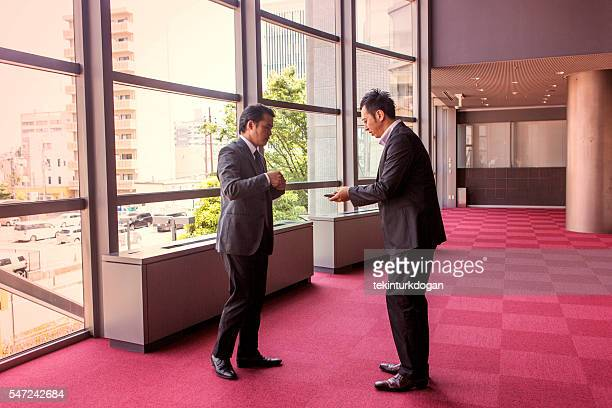 Salute card stock photos and pictures getty images japanese businessmen exchange business card in office at kyoto japan colourmoves