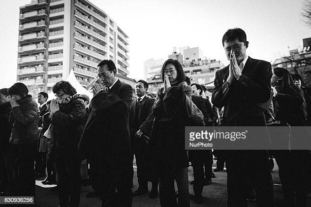 Japanese businessmen pray for prosperity of their firms during a New Year's ceremony at Kanda Myojin Shrine in downtown Tokyo on the first business...