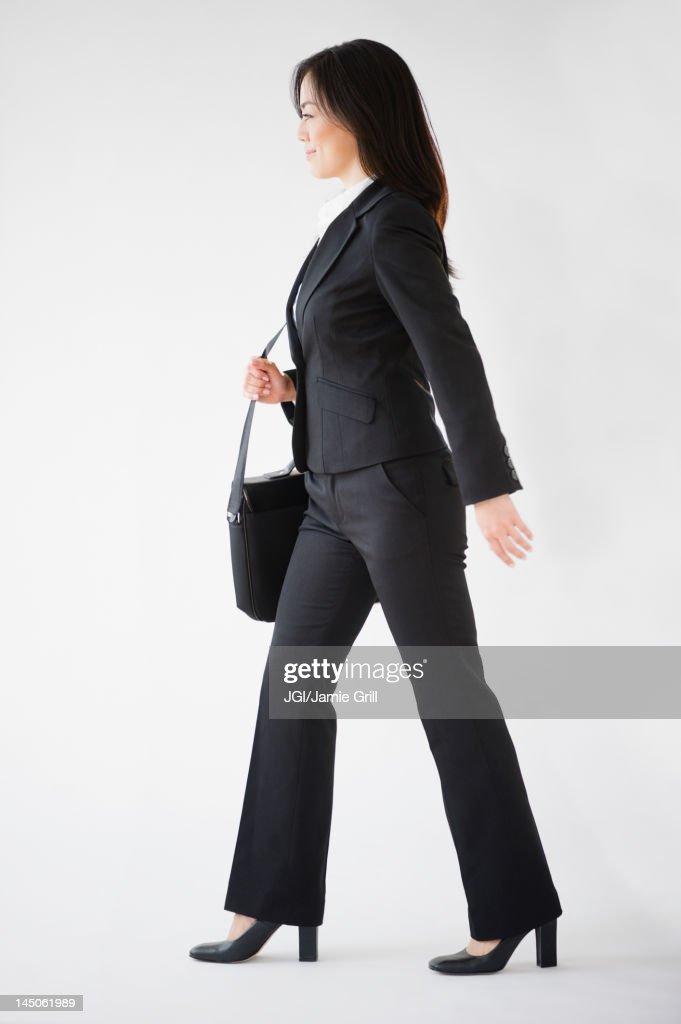 Japanese businesswoman carrying briefcase : Stock Photo
