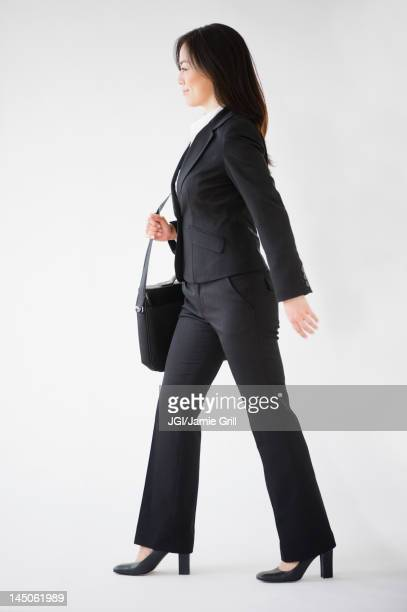 Japanese businesswoman carrying briefcase