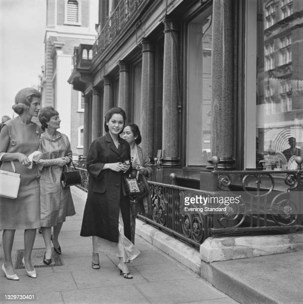 Japanese businesswoman Dewi Sukarno, the wife of Sukarno, President of Indonesia, in London, UK, 26th June 1965. She is attending the wedding party...