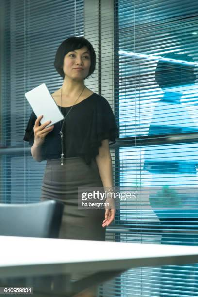 Japanese Businesswoman Holding Tablet Computer