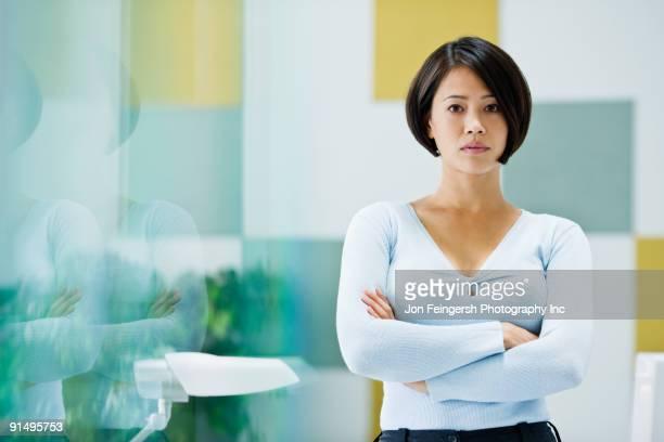 Japanese businesswoman posing in office