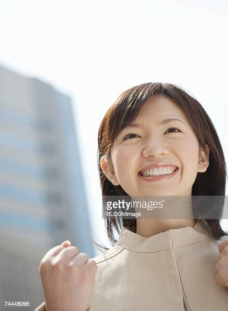 Japanese businesswoman smiling with making fist