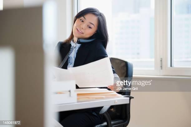 Japanese businesswoman talking on telephone