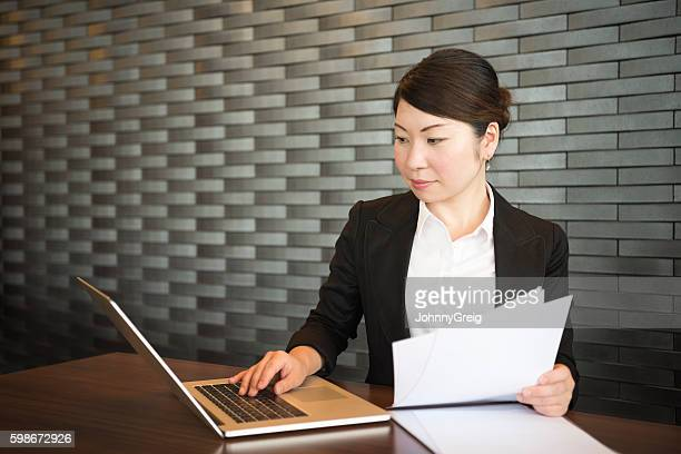 japanese businesswoman using laptop in office - input device stock photos and pictures