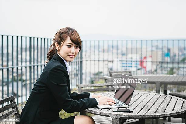 Japanese Businesswoman Working Outside