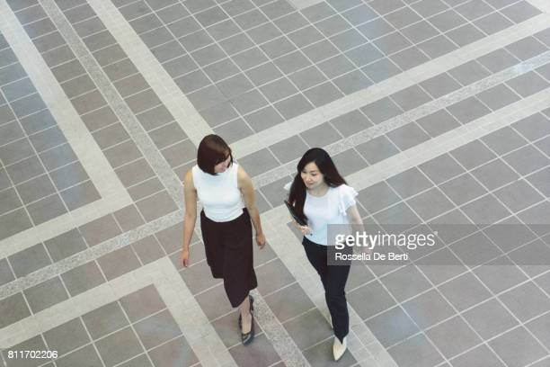Japanese businesswomen walking to the office