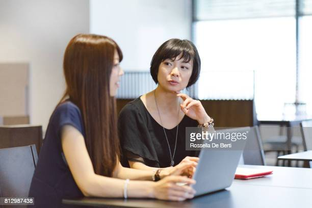 Japanese businesswomen working on a project in modern office