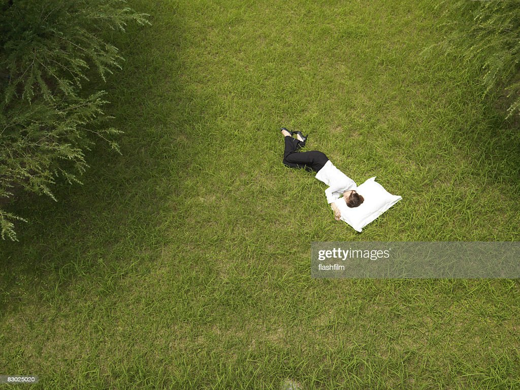 Japanese bussiness woman sleeping in park : Stock Photo