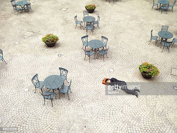 Japanese bussinessman sleeping outside