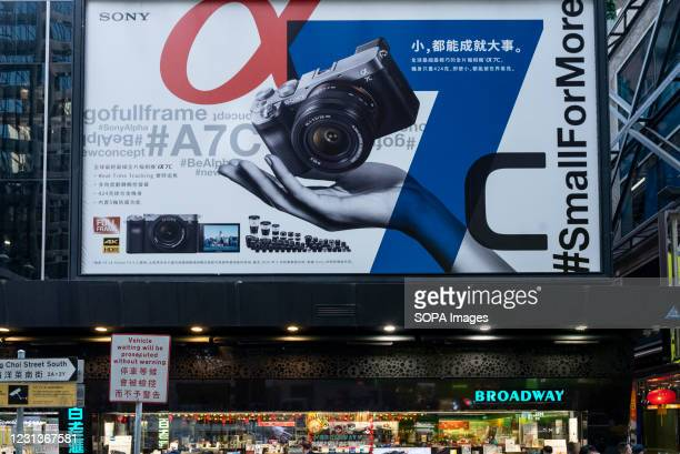 Japanese camera manufacturer brand Sony advertises its mirrorless camera Sony Alpha A7C on a large commercial billboard in Hong Kong.