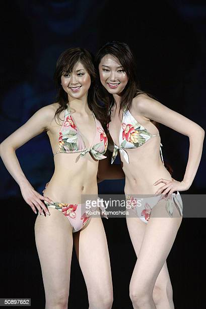 Japanese campaign girl Kana Watari and Chinese model Liuduo show off the new bikini for 2004 during the swimwear show of Japan's comprehensive...