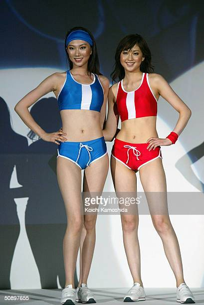 Japanese campaign girl Kana Watari and Chinese model Liuduo show off the new bikini for 2004 during the swimwear show of Japan's comprehensive...