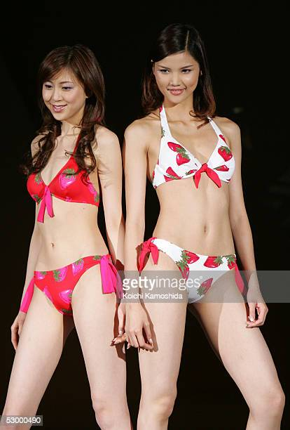 Japanese campaign girl Kana Watari and Chinese model Mo Wandan walk the runway as they model new bikini fashions for 2005 during the Asahi Kasei...