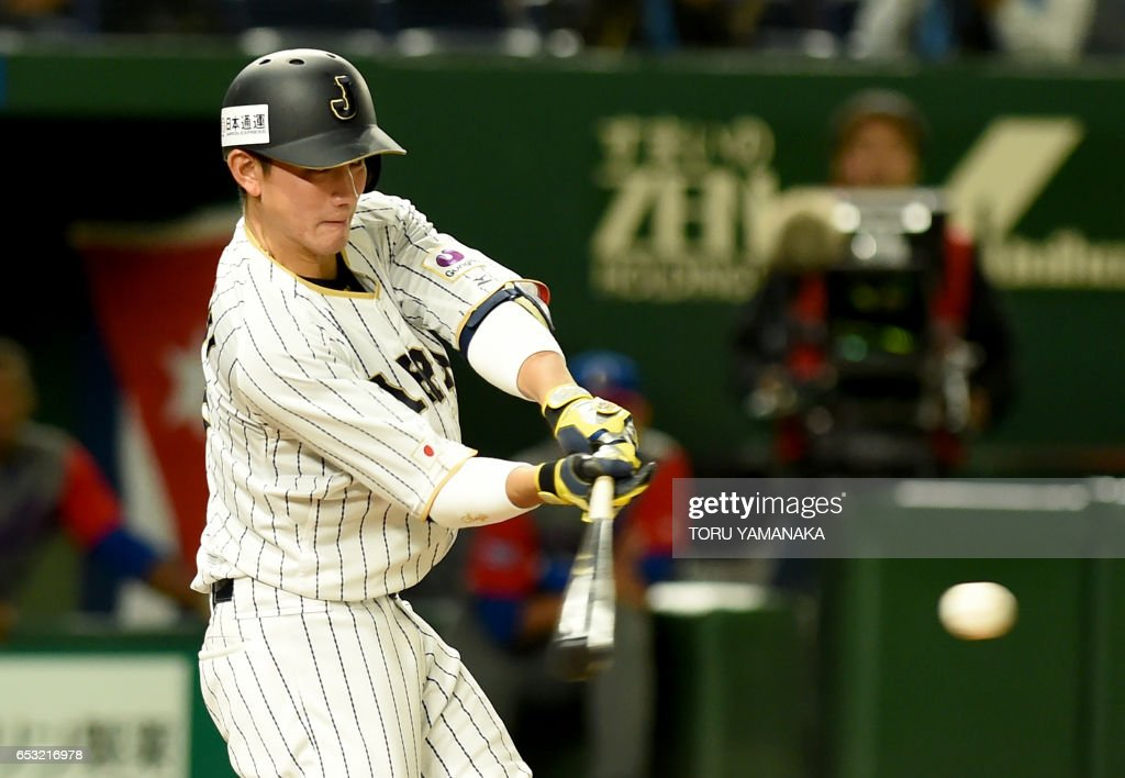 Japanese catcher Seiji Kobayashi hits an RBI single in bottom top of the sixth inning during the World Baseball Classic Pool E second round match between Cuba and Japan at Tokyo Dome in Tokyo on March 14, 2017. /