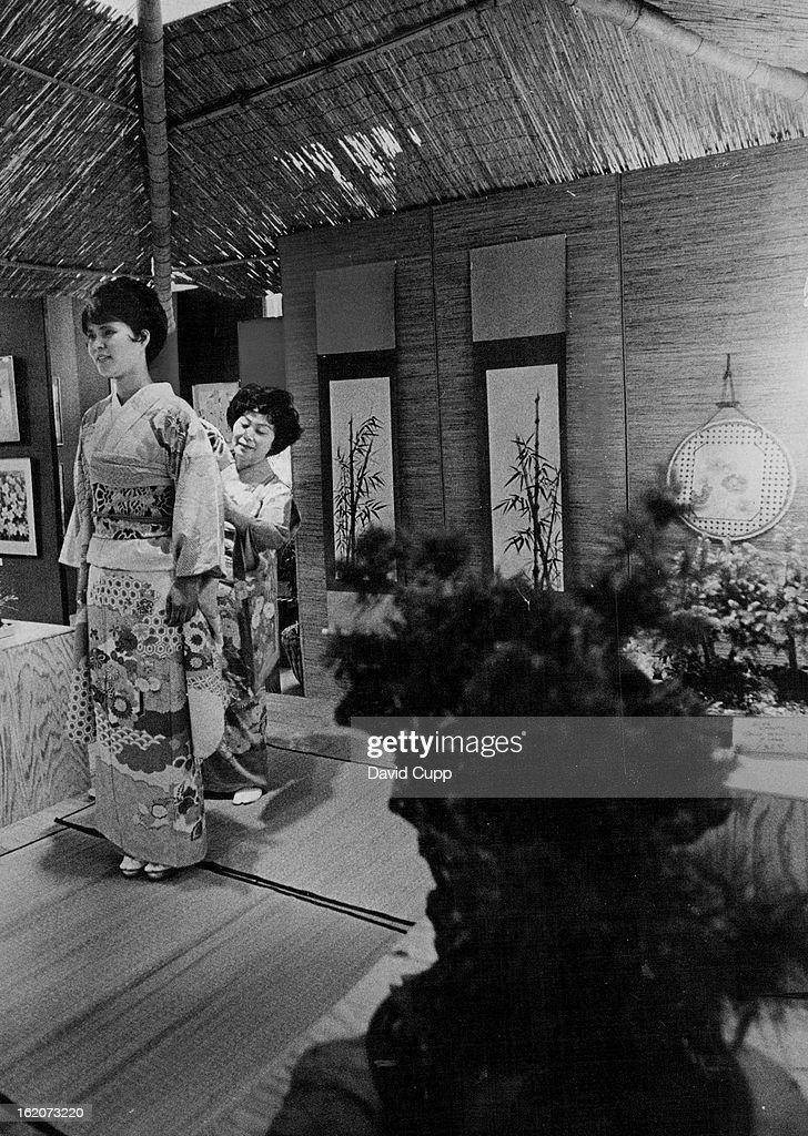 1970, MAY 26 1971; Japanese Ceremonial Dressing no Small Feat; Mrs. Catherine Kowakami, right, adjus : News Photo