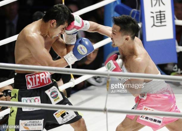 Japanese champion Daigo Higa connects with a right to challenger Moises Fuentes of Mexico during their WBC flyweight title boxing bout in Naha...