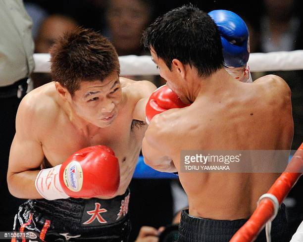 Japanese champion Hozumi Hasegawa strikes Uruguay's challenger Cristian Faccio in the first round of the WBC bantamweight title bout in Tokyo, on...