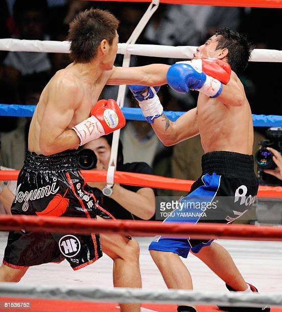 Japanese champion Hozumi Hasegawa strikes Uruguay's challenger Cristian Faccio with a left in the second round of the WBC bantamweight title bout in...