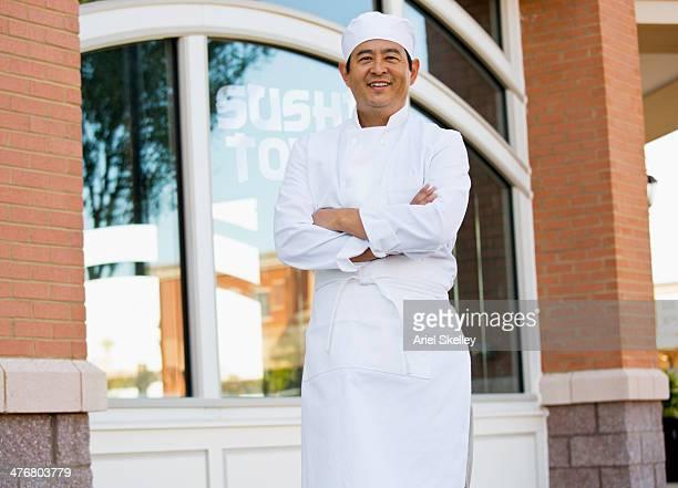 Japanese chef standing outside restaurant