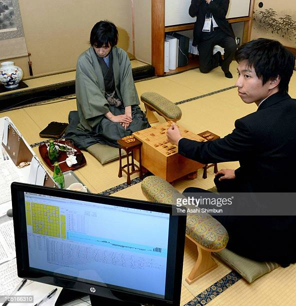 Japanese chess 'shogi' master Shinichi Sato looks dejected after being lost against 'Ponanza' program developed by Issei Yamamoto first ever defeat...