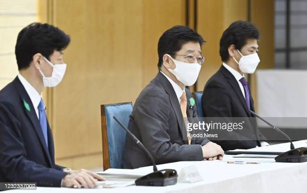 Japanese Chief Cabinet Secretary Katsunobu Kato speaks during a panel meeting on the coronavirus pandemic in Tokyo on April 16, 2021. With Prime...