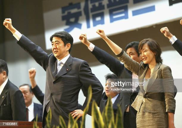 Japanese Chief Cabinet Secretary Shinzo Abe and his wife Akie Abe wave to voters during a press conference as he announces his intention to stand as...