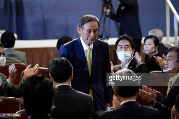 Japanese Chief Cabinet Secretary Yoshihide Suga acknowledges as he is elected as new head of Japan's ruling party at the Liberal Democratic Party's...