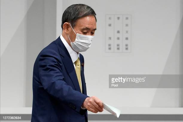 Japanese Chief Cabinet Secretary Yoshihide Suga casts his ballot for the Liberal Democratic Party's leadership election on September 14 2020 in Tokyo...