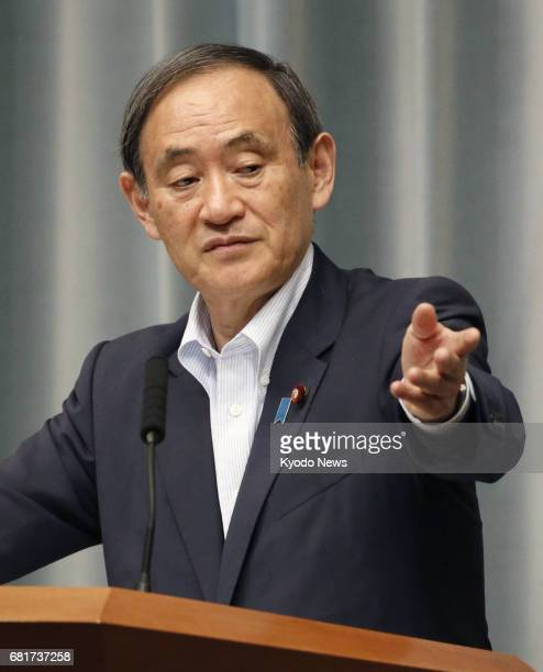 Japanese Chief Cabinet Secretary Yoshihide Suga holds a regular press briefing in Tokyo on May 11 2017 The top government spokesman welcomed the...