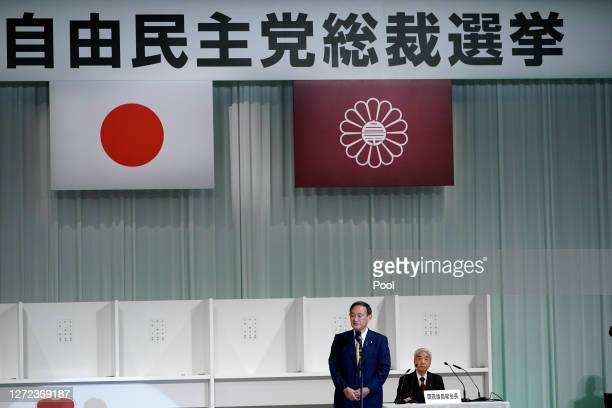 Japanese Chief Cabinet Secretary Yoshihide Suga speaks after he is elected as new head of Japan's ruling party at the Liberal Democratic Party's...