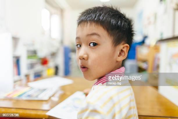 Japanese Child Looking At Camera