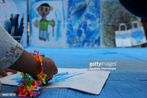 Japanese child writes art as massage for light it up blue campaign for world Autism Awareness Day on April 2 2015 in Himeji Japan World Autism...